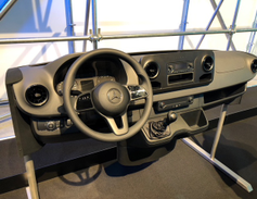 The level two dashboard offers more steering wheel controls and a head unit.