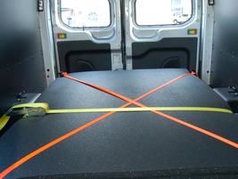 The cargo vans were loaded with 1,200 pounds of rubber mats to simulate real-world driving...