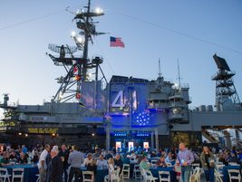 The second day's evening reception was held on the deck of the USS Midway aircraft carrier.