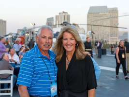 (l to r) Atop the USS Midway during the second night's reception, Phil Screiber, fleet manager...
