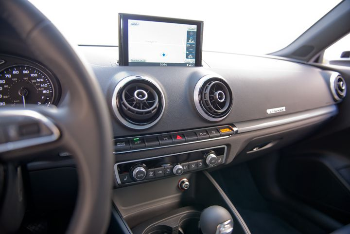 A 7-inch display retracts into the dashboard when the vehicle is powered off.