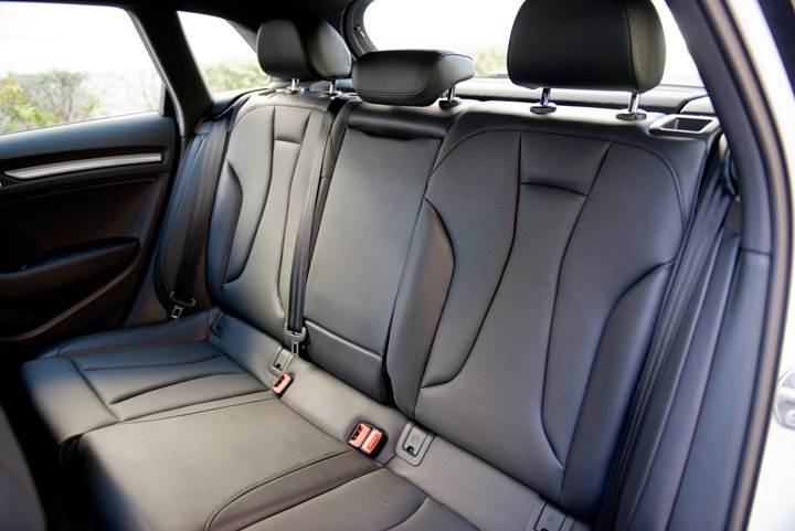 A rear bench seat accommodates two adults and a third smaller adult or child.
