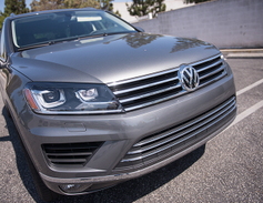 The Touareg pairs adaptive bi-xenon headlights with LED DRLs.