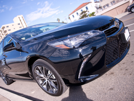 Toyota added a more prominent trapezoidal grille to the Camry's front end.