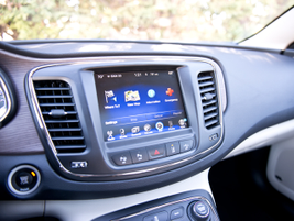 An optional 8.4-inch touchscreen display provides navigation, Uconnect with Bluetooth phone...