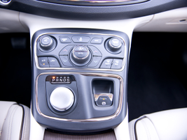 A/C temperature and dual zone climate controls are accessible on an angled platform on the...