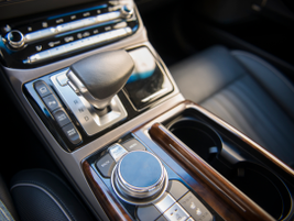 The G90 uses a joystick-style electronic shifter and multimedia controller dial.