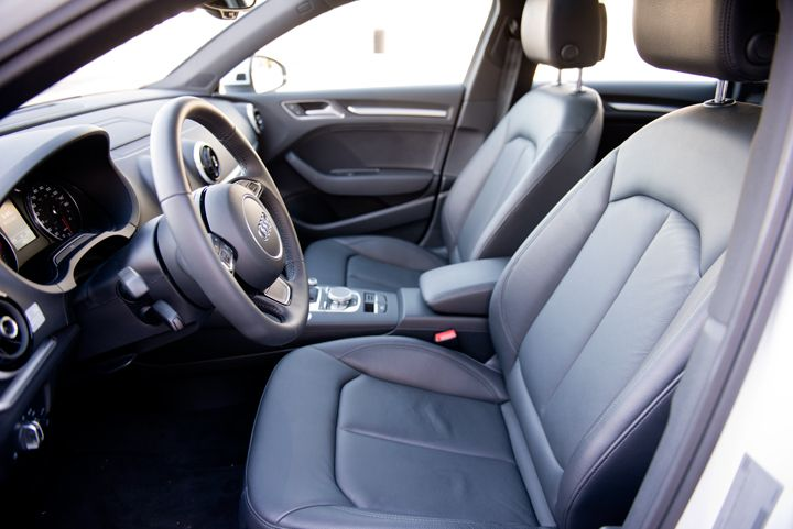 A 12-way power adjustable driver's seat includes leather surfaces.