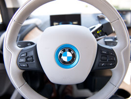 The leather-trimmed steering wheel included controls for the infotainment system. The shifter is...