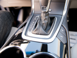 The parking-assist feature is activated by pressing a button on the right side of the shifter.