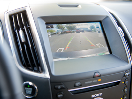 A 4.2-inch LCD screen serves infotainment data and backing images.