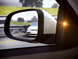 A blind spot information system (BLIS) available on the 2014 S60 and XC60 alerts the driver to...