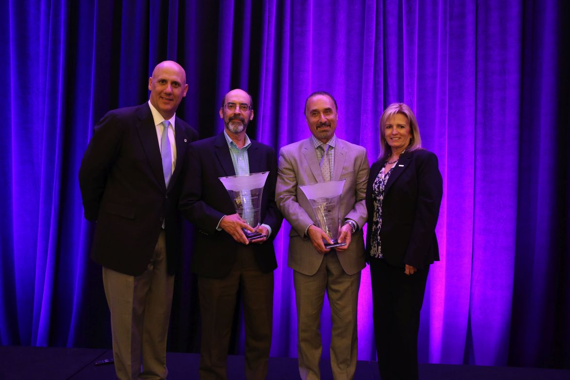 Tom Webb (second from left) of Cox Automotive and Tom Kontos (third from left) of ADESA received...