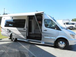 A MY-2015 Sprinter converted into a Winnebago Touring Coach is displayed.