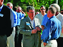 GM's Don Johnson speaks with a customer at the event.