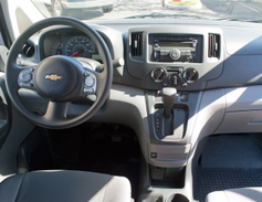 The inside features a center console storage with a standard file folder bin and a 12-volt power...
