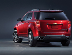 The exterior has a revised license plate applique and lower rear fascia on all models, with...