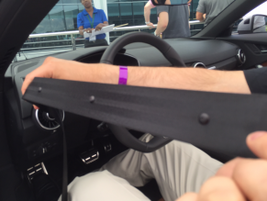 The 2016 Audi TT features microphones built into the driver's seat belt.