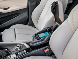 The vehicle offers a wireless charging pad that's embedded in the center storage bin.