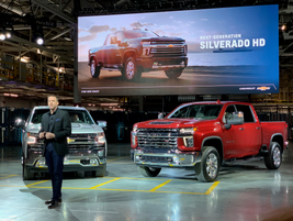 Rich Scheer, director, Exterior Design, Chevrolet Trucks displayed the light-duty and heavy duty...