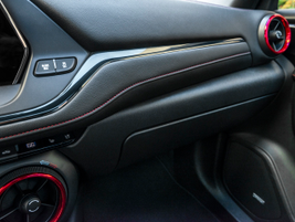 A button mounted higher on the dash opens the glovebox, which can function in valet mode.