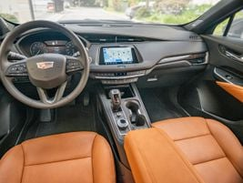 A bright,8-inch touchscreen displays Cadillac's CUE software.