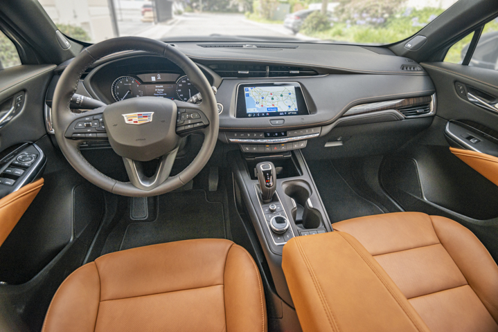 The interior includes a bright, 8-inch touchscreen that displays Cadillac's CUE software.