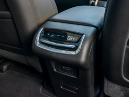 Climate controls mounted to the rear of the center storage bin allow rear passengers to dial in...
