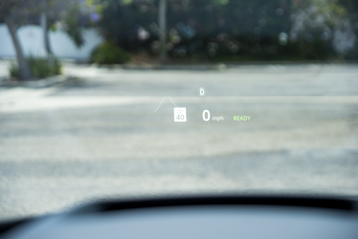 A heads up display provides relevant information such as the vehicle's current speed, local...