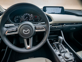 Standard features include cloth seats and an 8.8-inch infotainment screen.