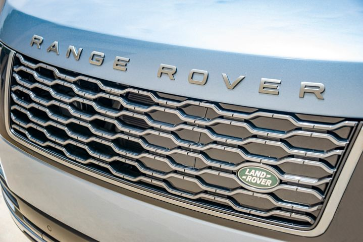 Range Rover has hidden the vehicle's charging point in the grille.