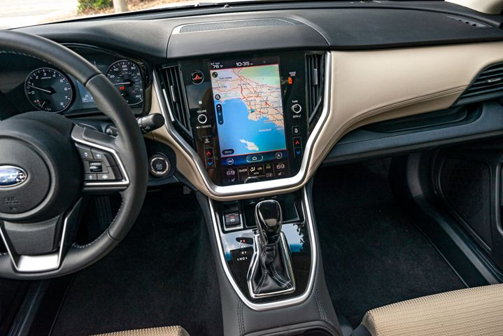 An 11.6-inch bright, portrait-style touchscreen is embedded in the dash.