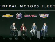 "Ed Peper, U.S. VP of GM Fleet, far left, moderated a ""fireside chat"" with (L-R) EVP & CFO Dhivya..."