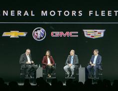 "Ed Peper, U.S. VP of GM Fleet, far left, moderated a ""fireside chat"" with (L-R) EVP & CFO Dhivya..."