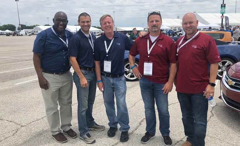 Jim Bigelow, director, enterprise fleet (middle) stands with his Cox Enterprises fleet team and...