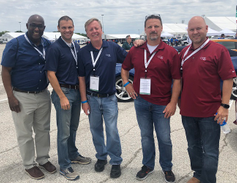 Jim Bigelow, director, enterprise fleet (middle) stands with his Cox Enterprises fleet team and...