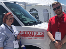 Julie Bergs, global fleet manager for NCR, poses for a photo with Mike Scozzaro of Auto Truck,...