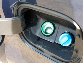 The DEF filler is located inside the fuel filler door in the 2020 Sierras.