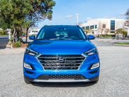 The Tucson offers a revised grille and headlamps, as well as three new exterior colors,...
