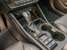 Here's a closer look at the shifter and several compartments for small items.