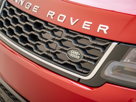 The electric charge port is cleverly hidden in the Range Rover Sport's front grille.