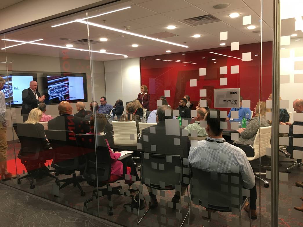 Attendees gather in one of the new meeting rooms.