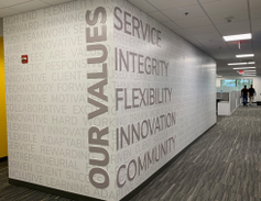 The company's values are emblazoned on a wall.