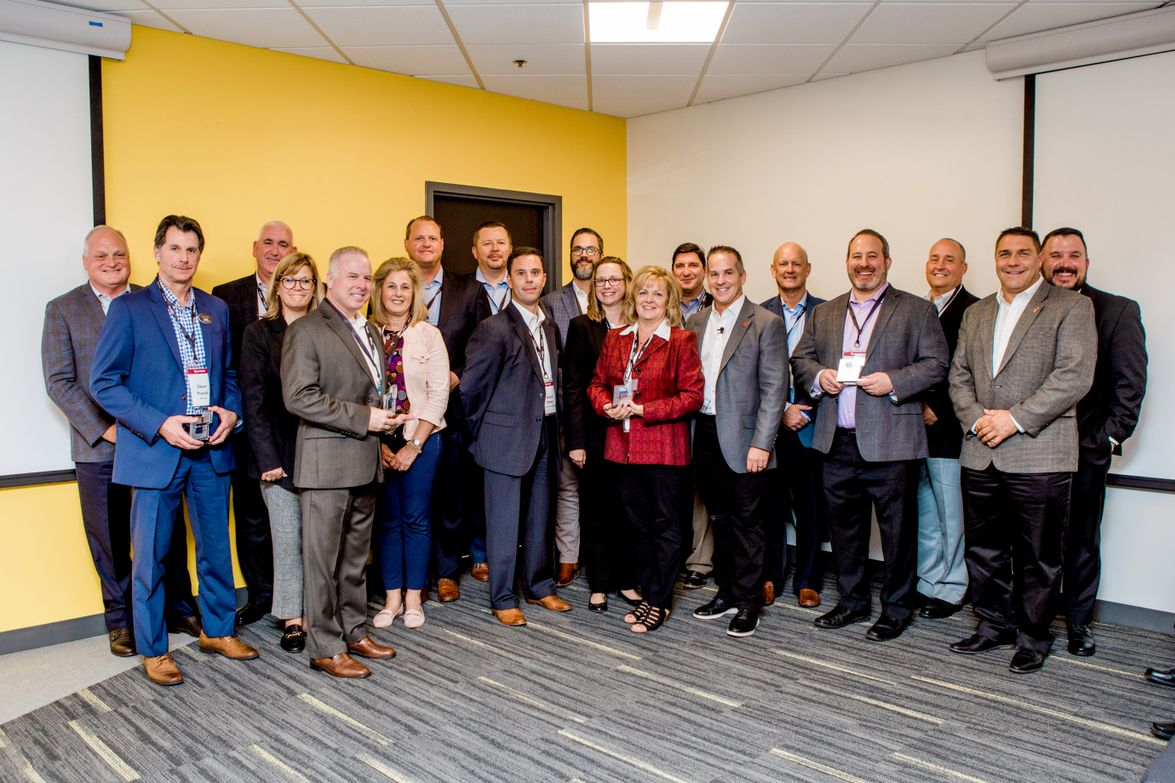 Representatives from automotive manufacturers were recognized for their long partnerships with...