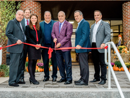 Merchants Fleet's leaders cut the ceremonial ribbon on the new headquarters.