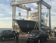 One demo highlighting the 2020 GMC Sierra HD towing capability included towing a wheeled crane...