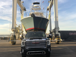 This photo captures the brute towing capability of the GMC Sierra HD as it towed a crane with...