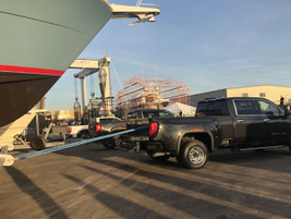 The towed crane was tethered to a fifth wheel in the bed of the 2020 GMC Sierra.