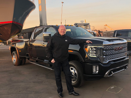 Matt Noone, director of GMC exterior design, poses proudly with the 2020 GMC Sierra HD.