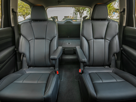 This three-row SUV can haul seven passengers and offers second-row captain's chairs on higher...